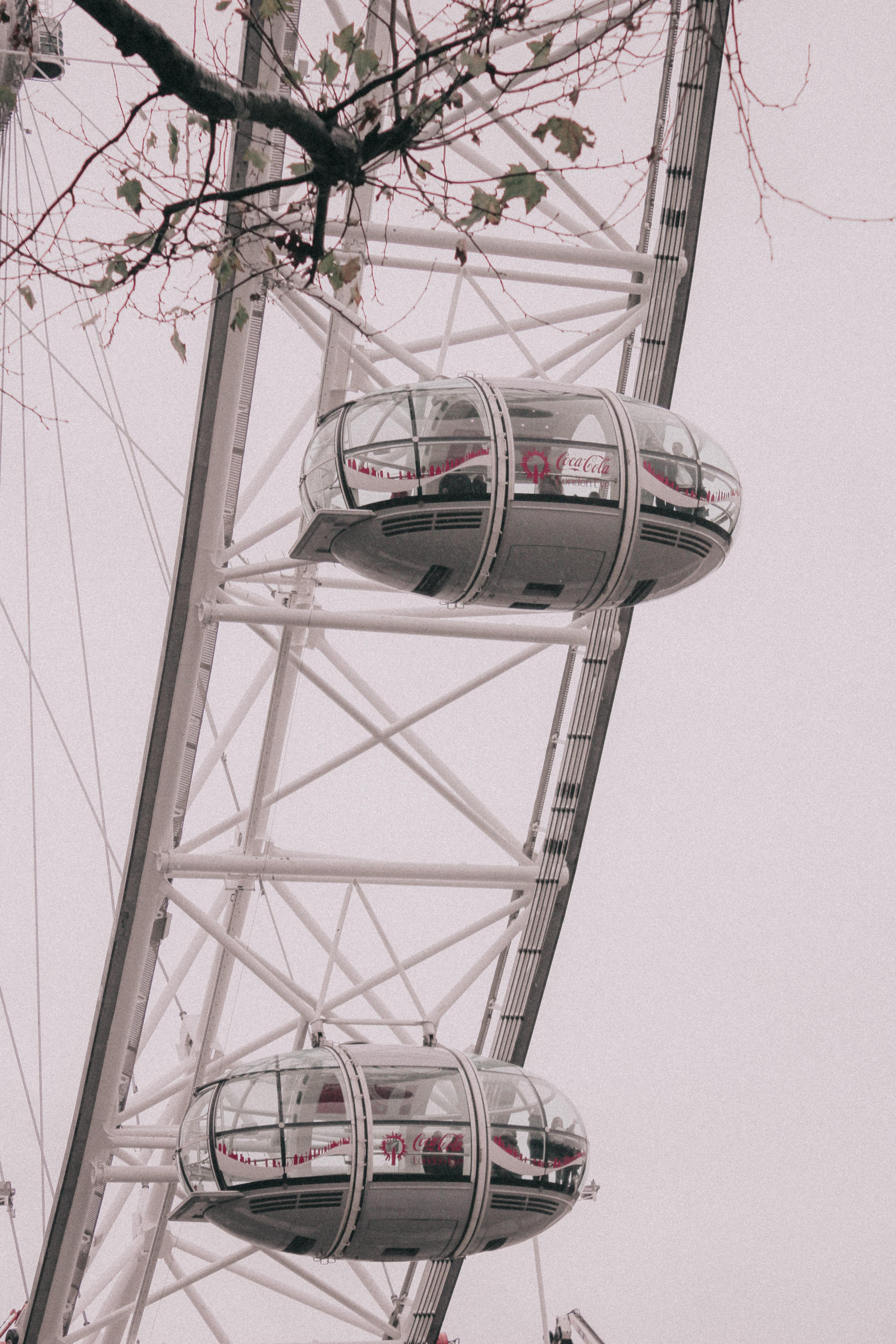 white Ferris wheel under gray skies