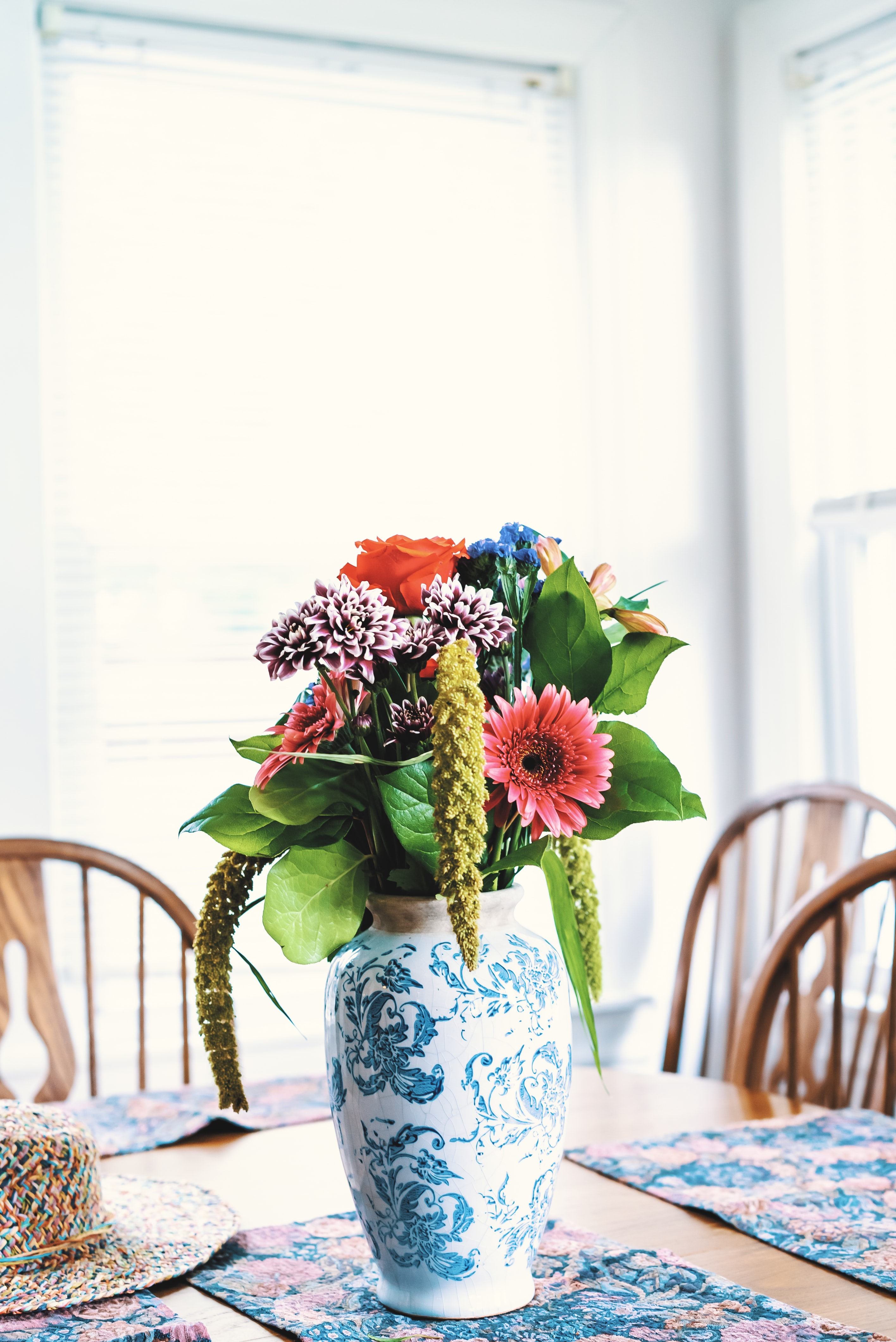 assorted-color flowers centerpiece on green floral mat