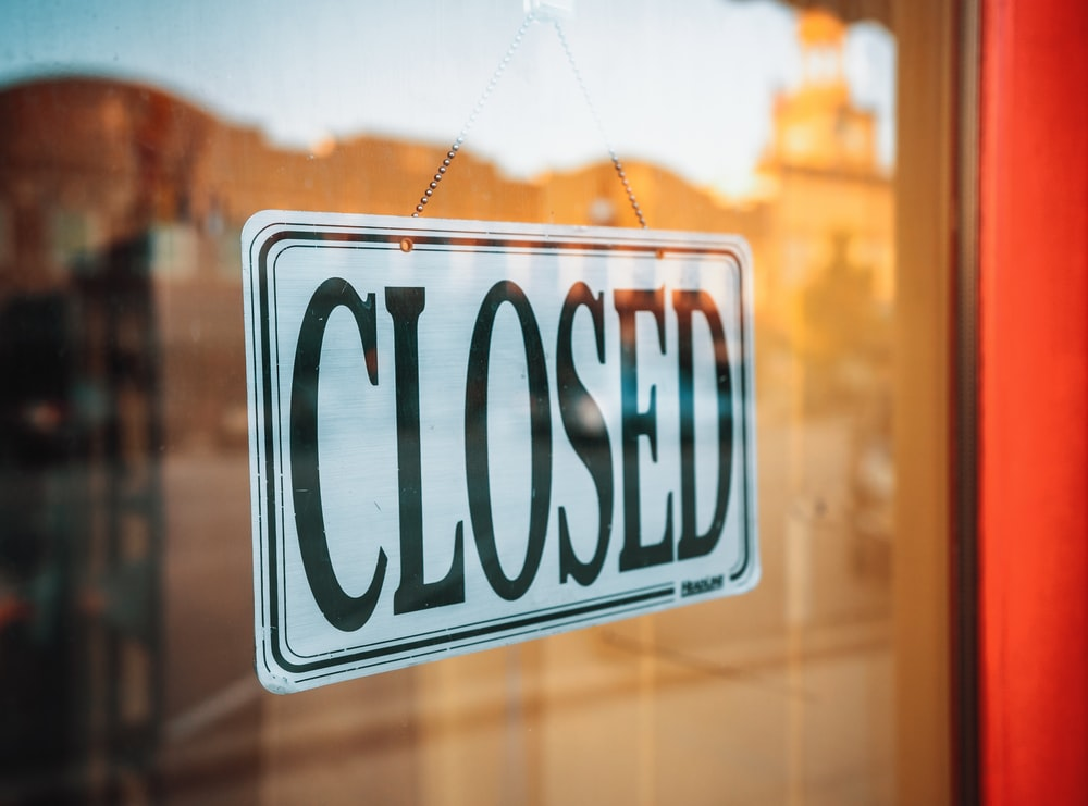 selective focus photography of Closed signage