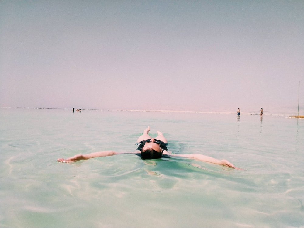 person floating on sea