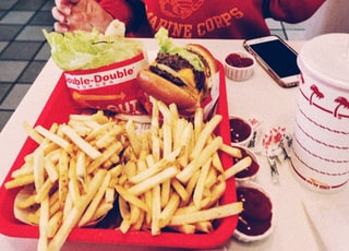 fries and burger in red container