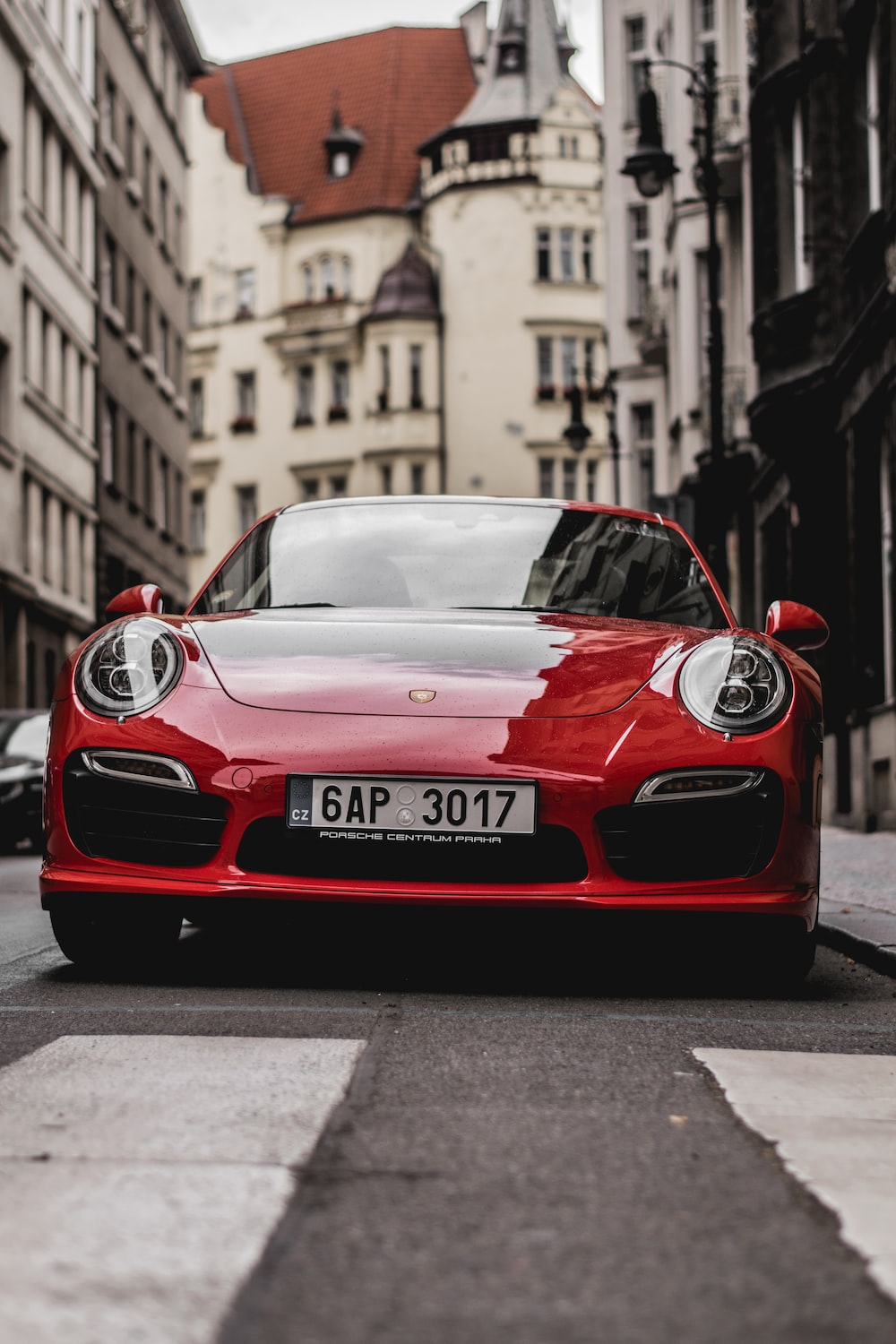 Red Porsche Vehicle During Daytime
