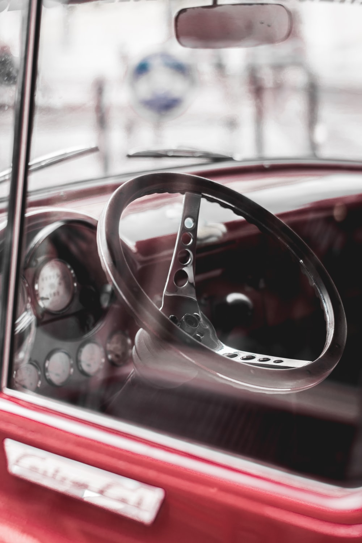 closeup photo of black steering wheel