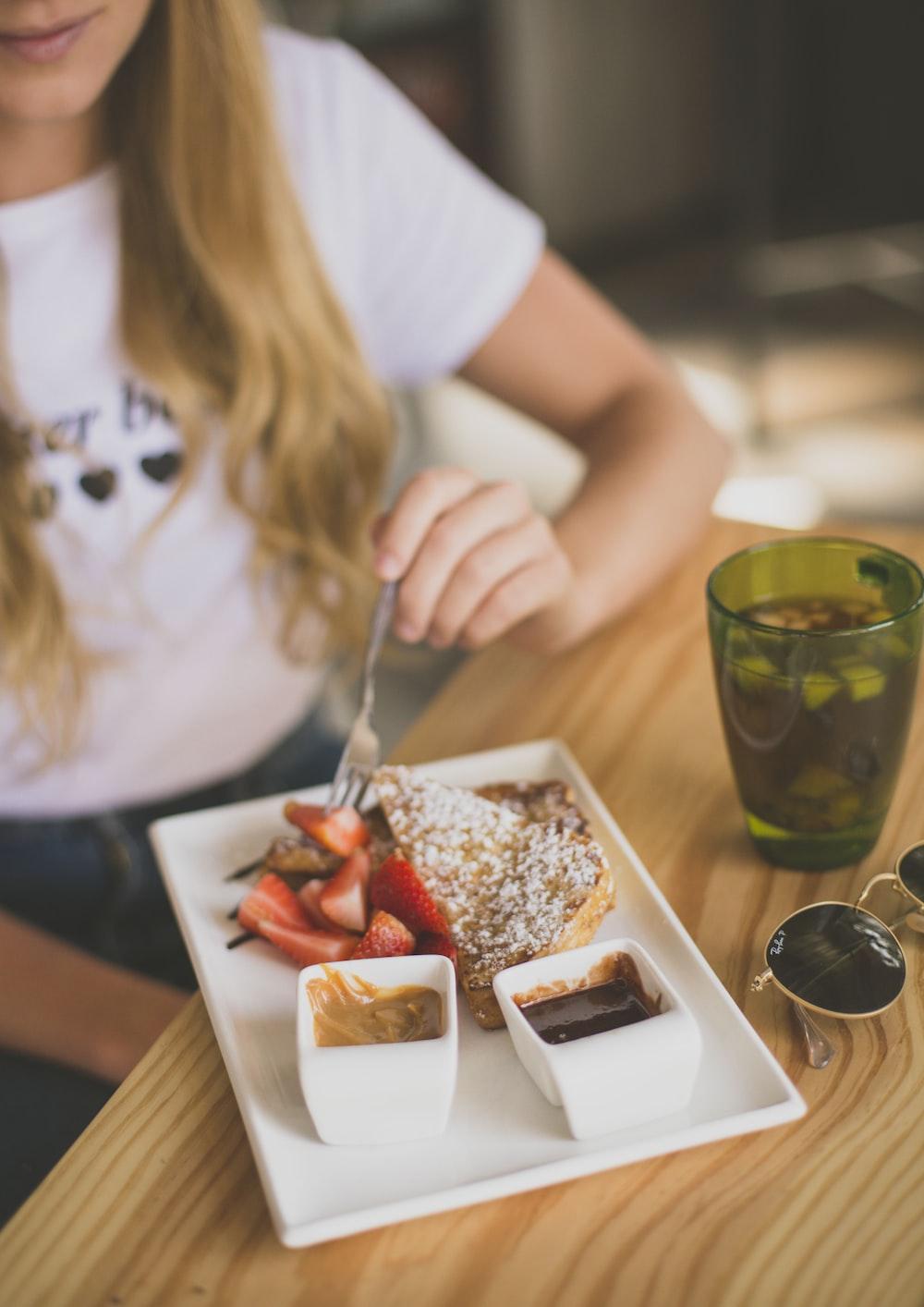 girl eating strawberry waffle