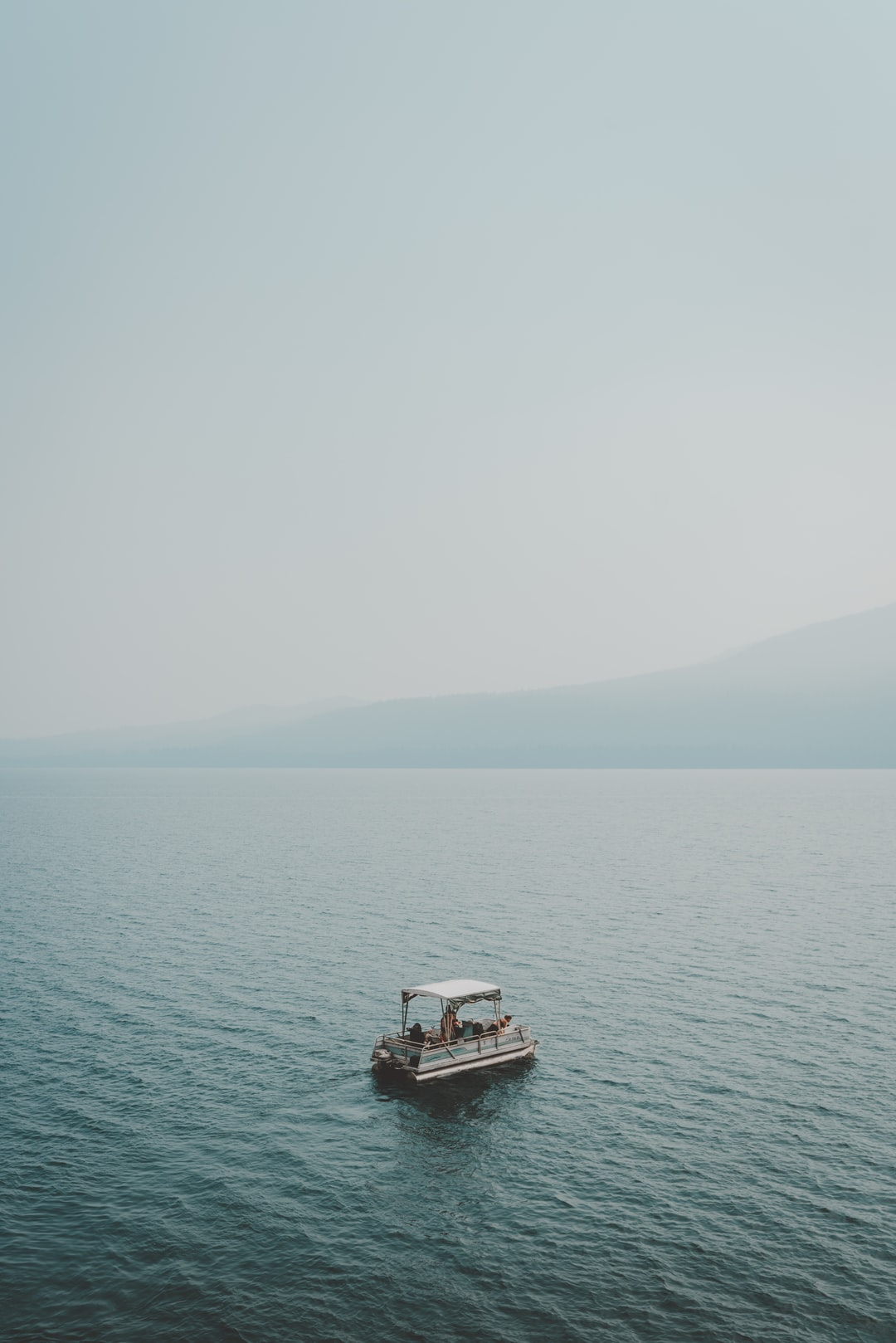 Just a lil boat sitting on top of Diamond Lake, Oregon.