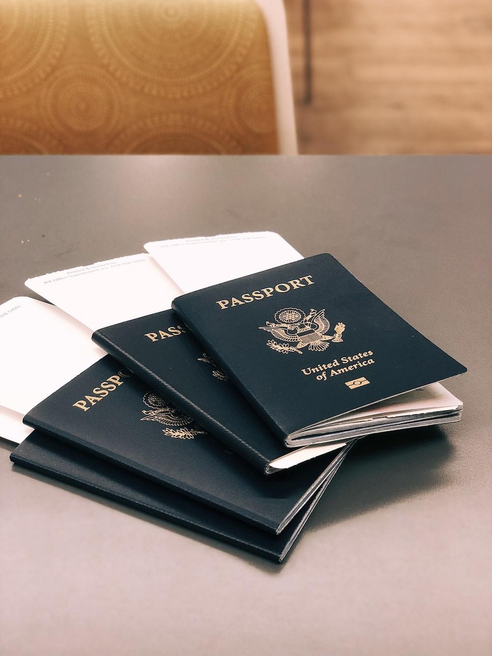four green Passports