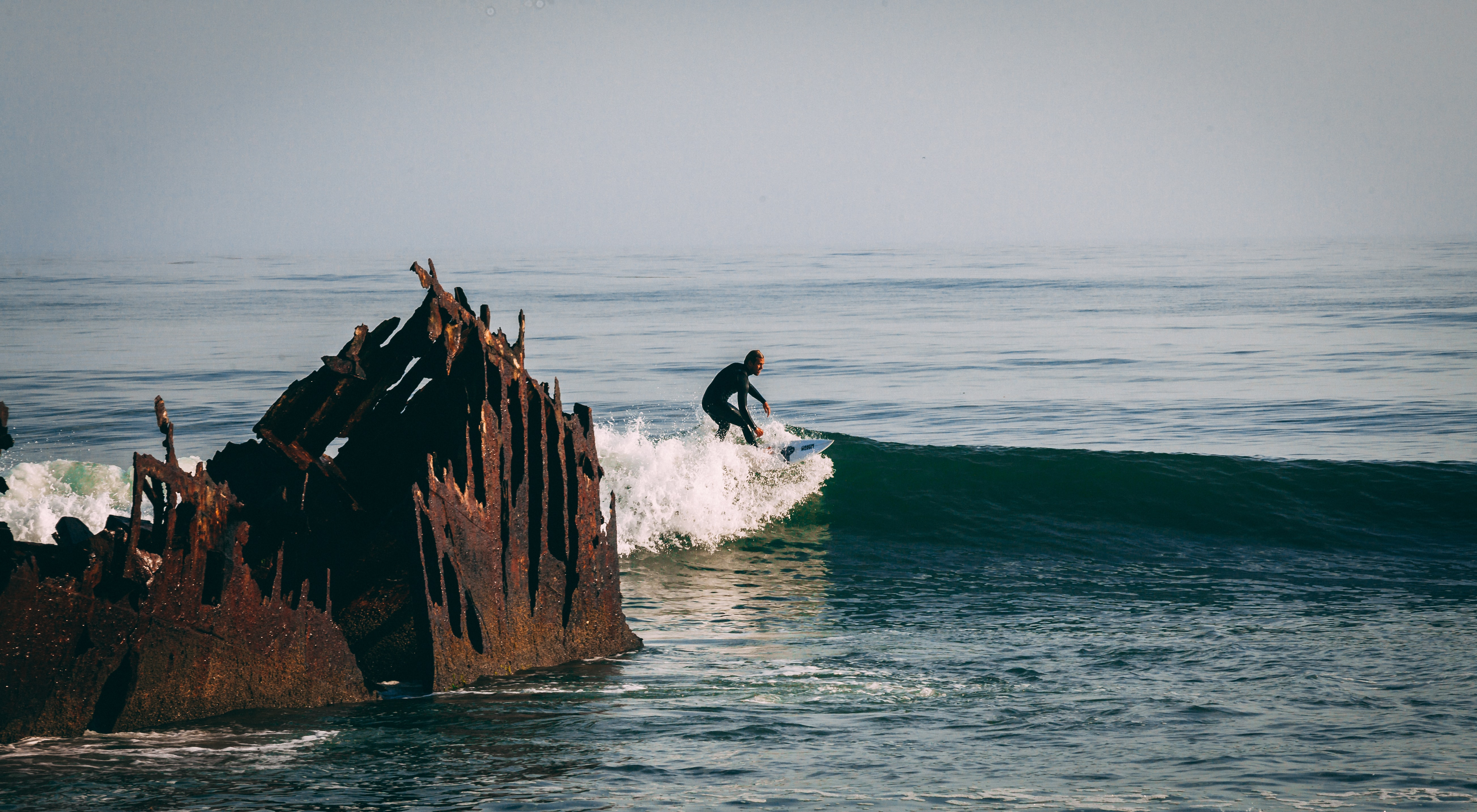 man surfing the waves during day