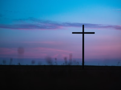cross stand under purple and blue sky christianity teams background