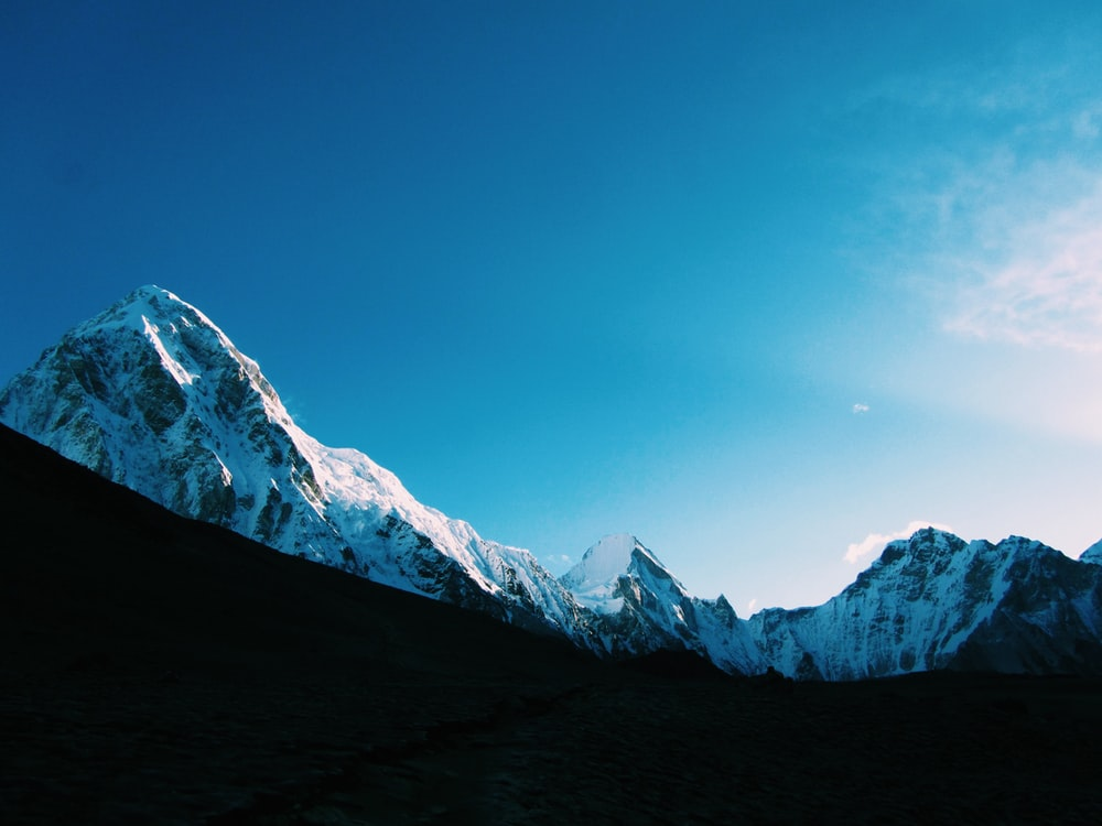 low angle photography of mountain covered by snow