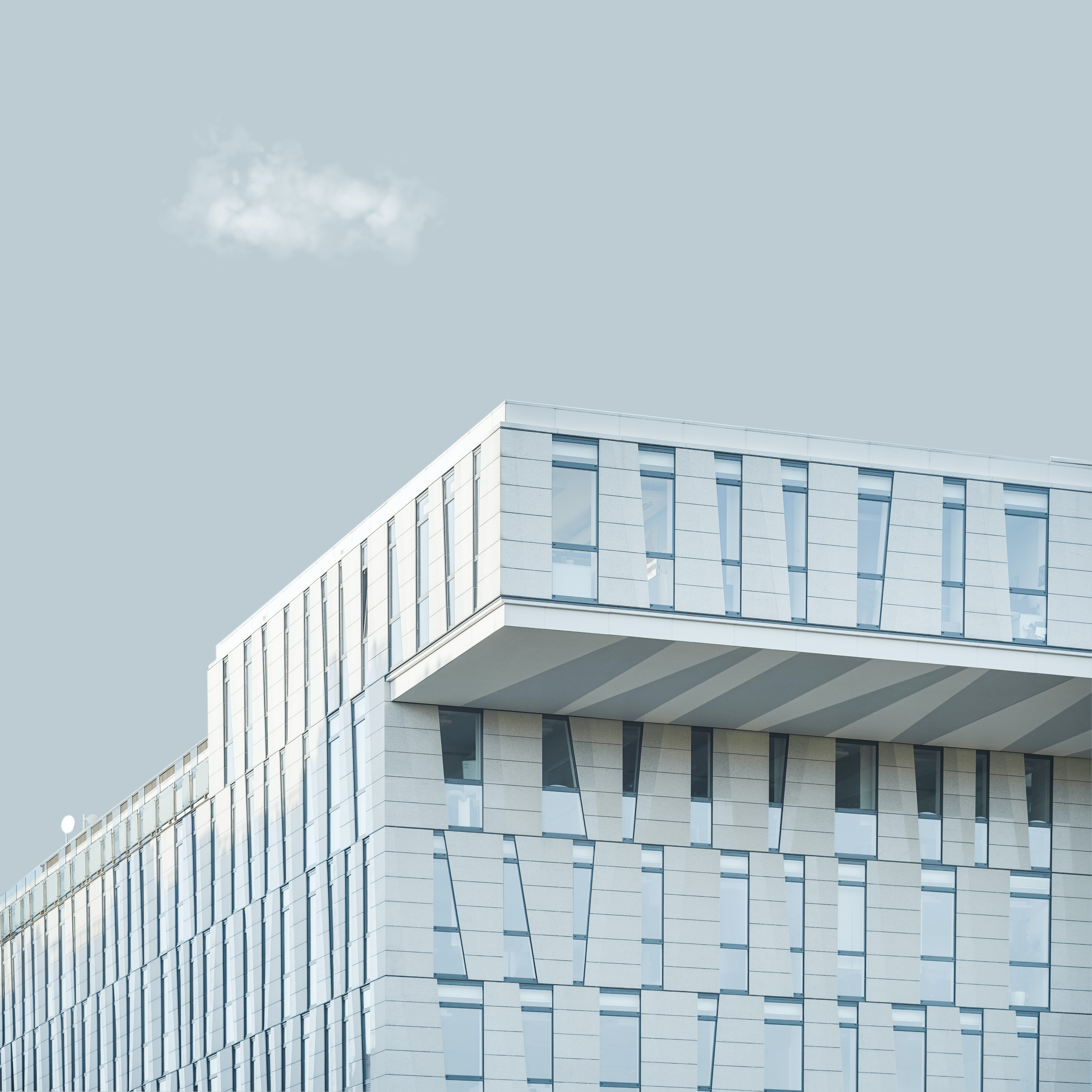 architectural photography of white concrete building