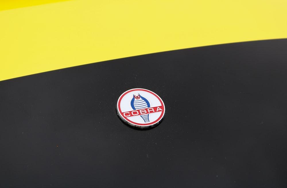 Cobra badge pin