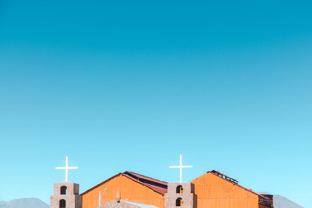 brown wooden church under blue sky during daytime