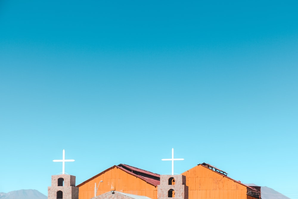 brown wooden church under blue sky during daytime