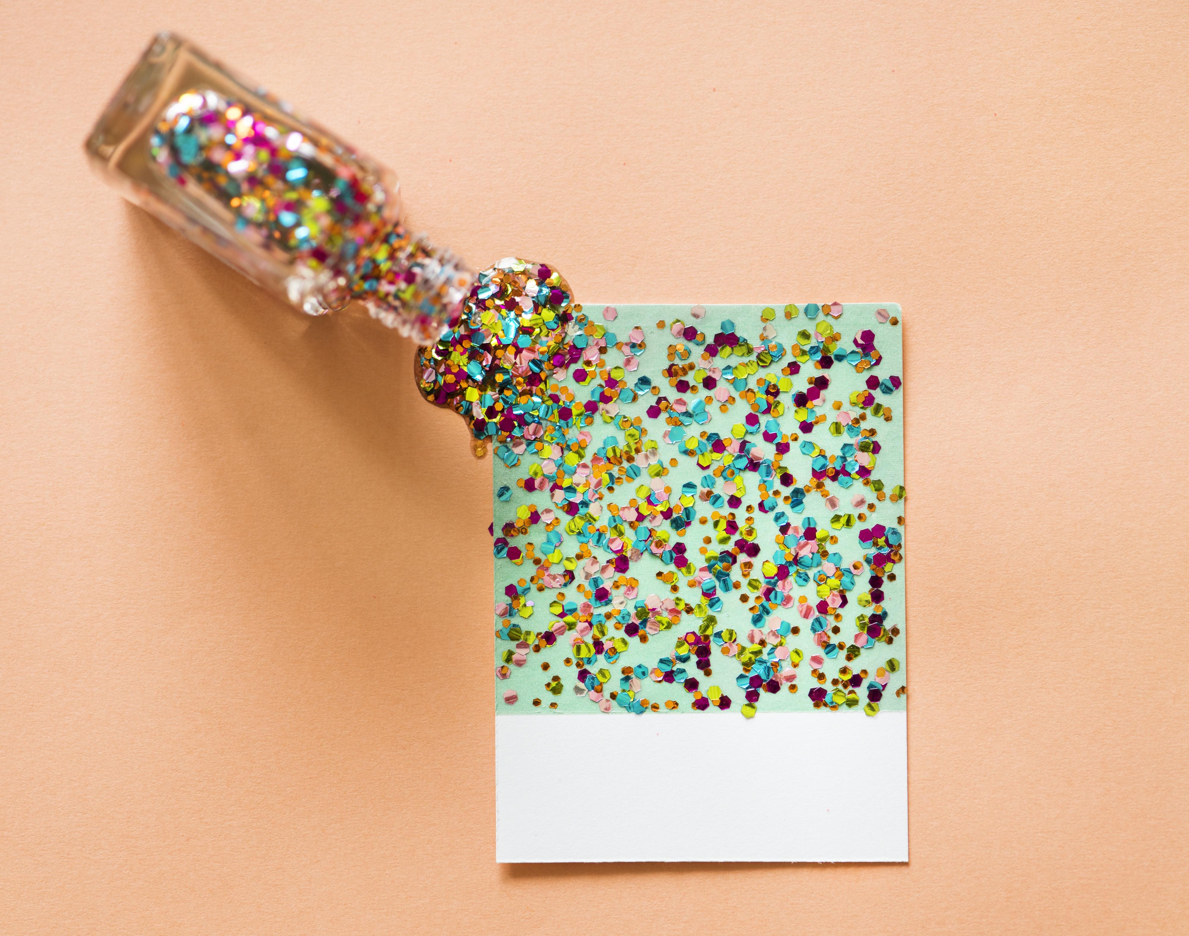 multicolored glitter art on paper