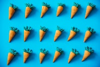 carrot toys on blue surface