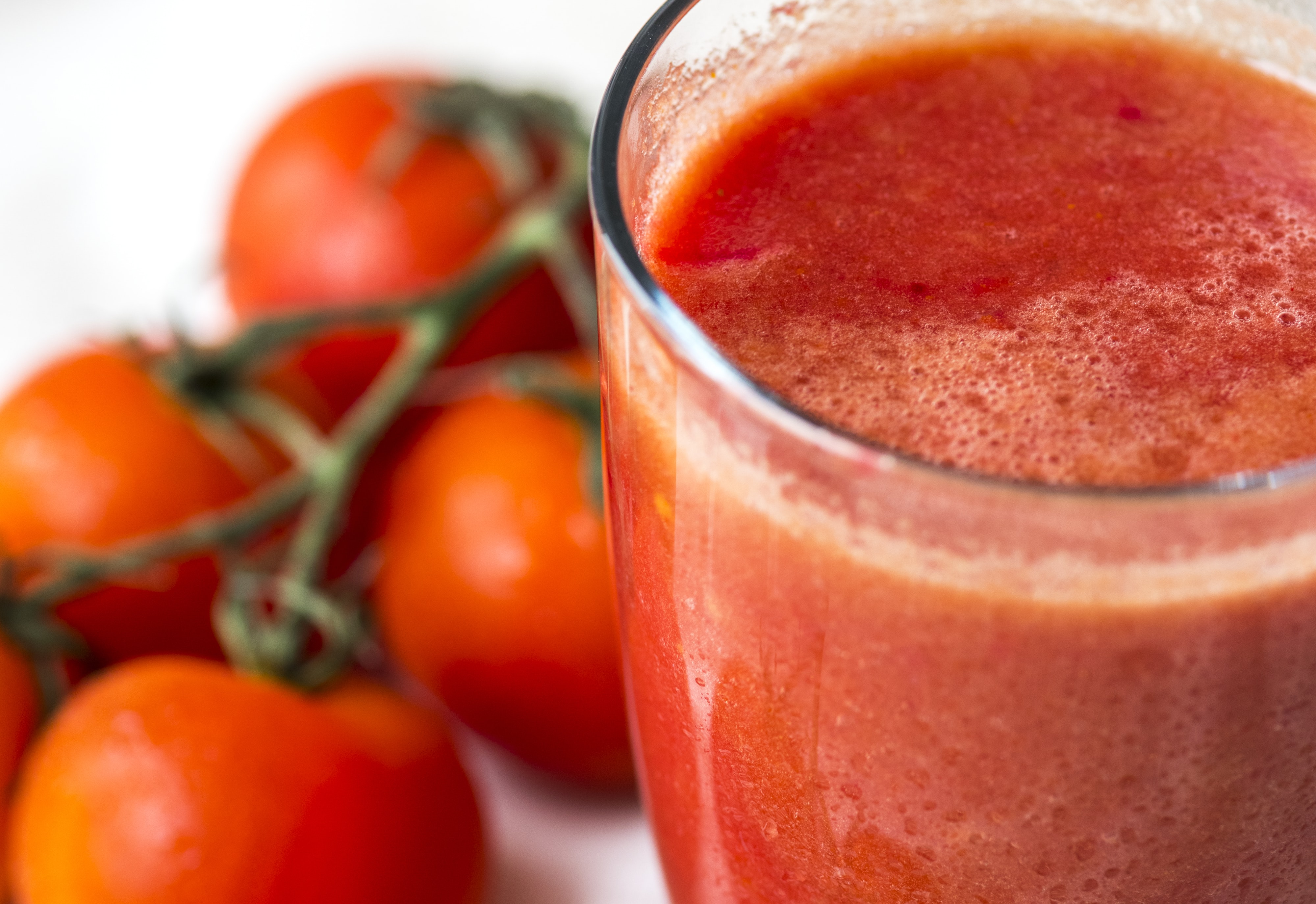tomato juice in clear drinking glass