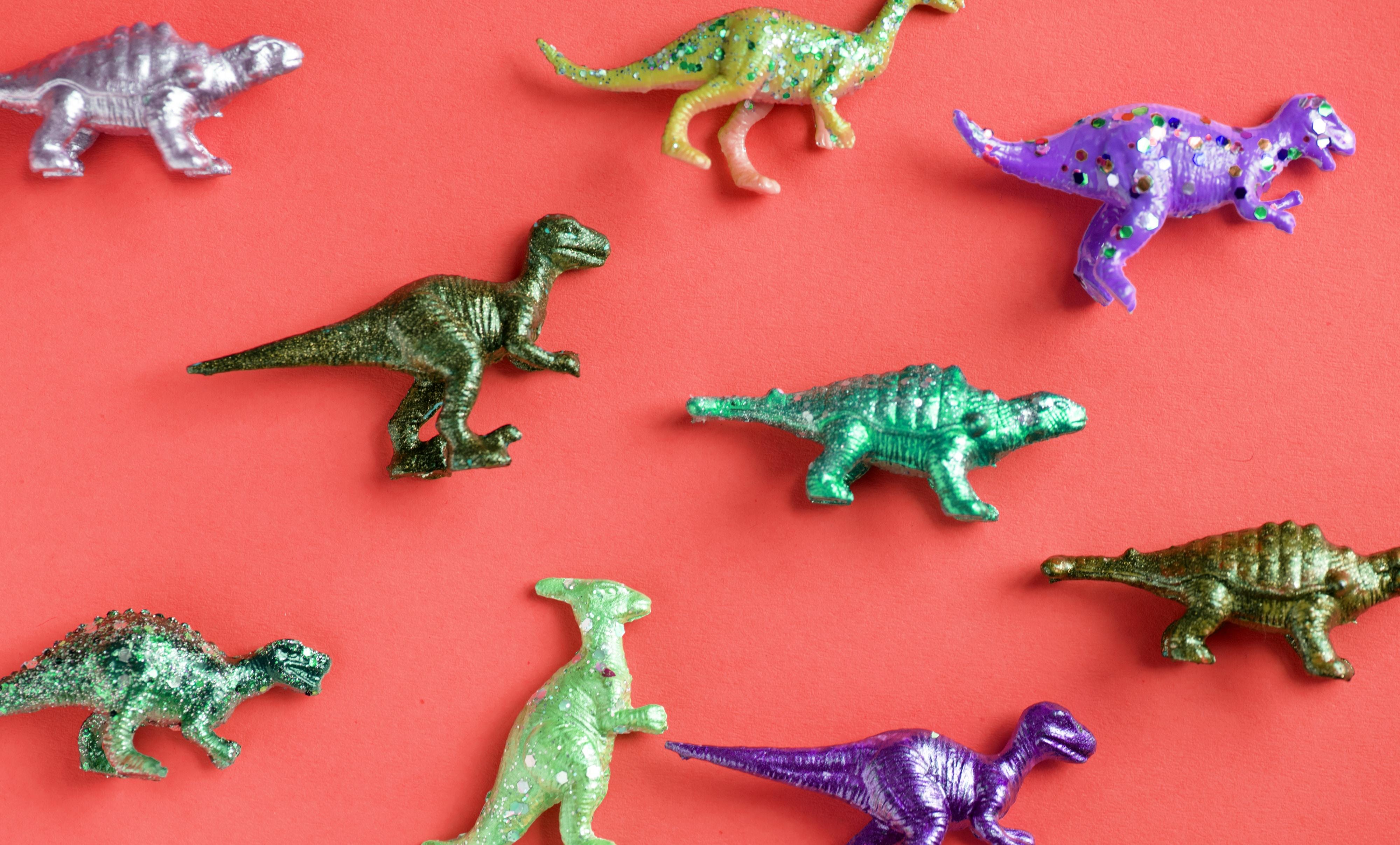 nine assorted-color plastic dinosaur toys