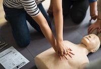 person performing CPR training