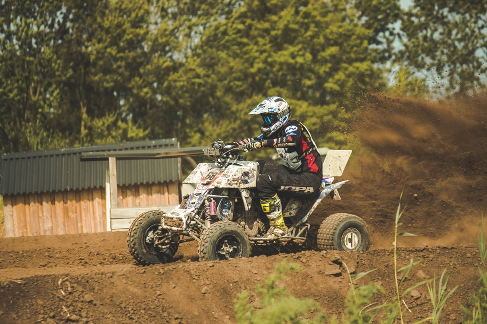 ATV rider on dirt track at daytime