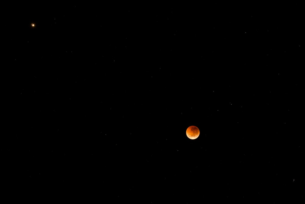red blood moon in sky during nighttime