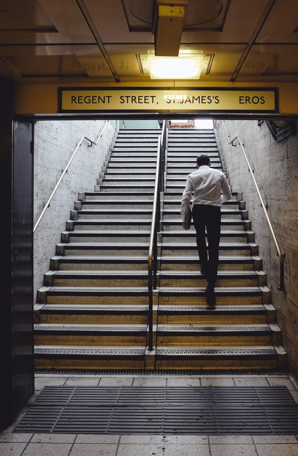 man walking on stairs at daytime