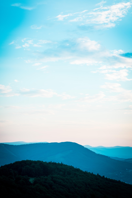 green mountain under white cloud