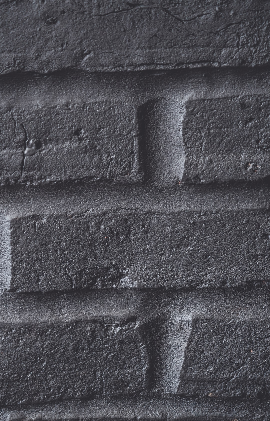 Dark gray brick wall texture background