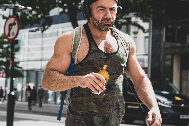 man holding brown bottle