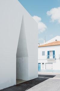 white concrete building near house