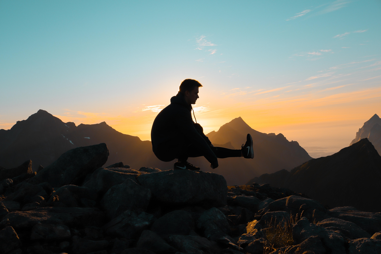 silhouette on man on mountain