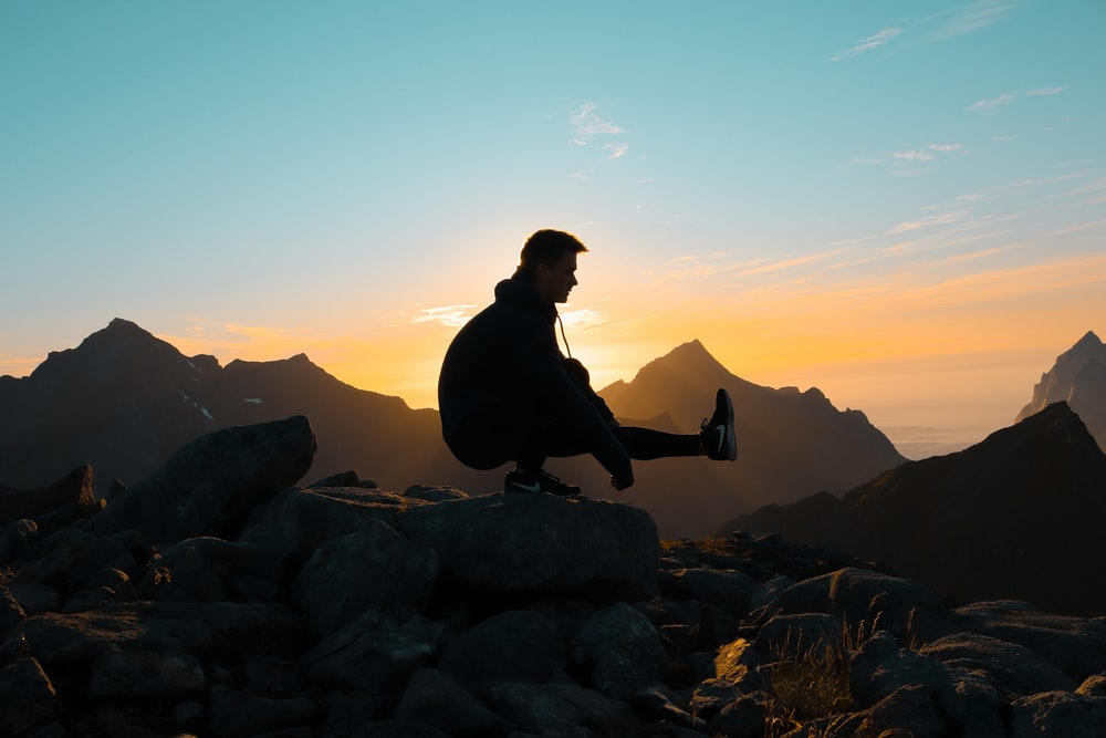 silhouette on man on mountain