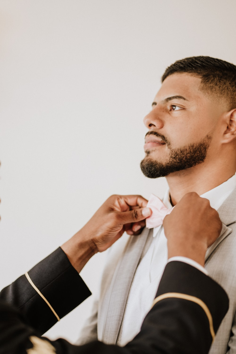 man in white coat and bowtie