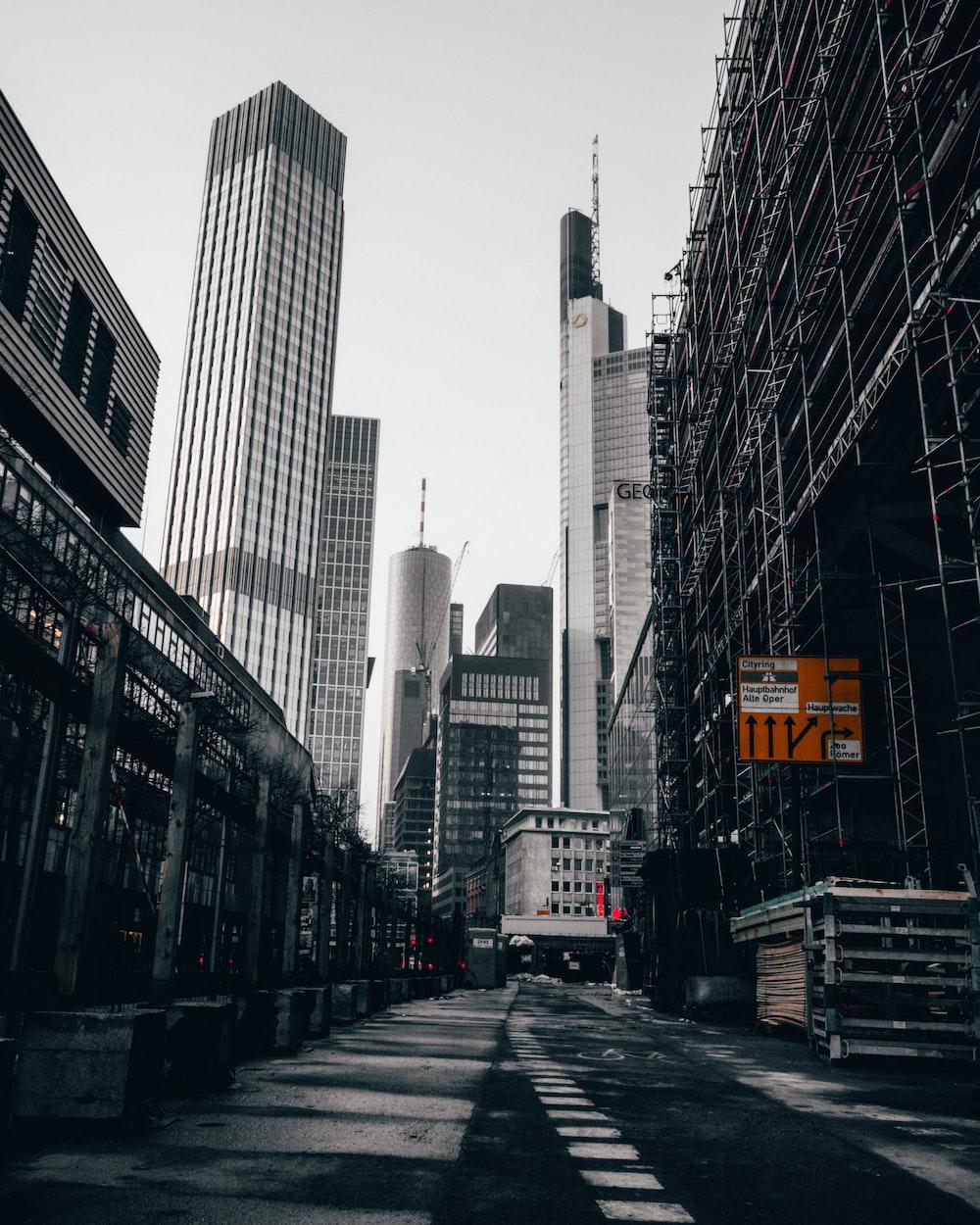 gray road between skyscrapers