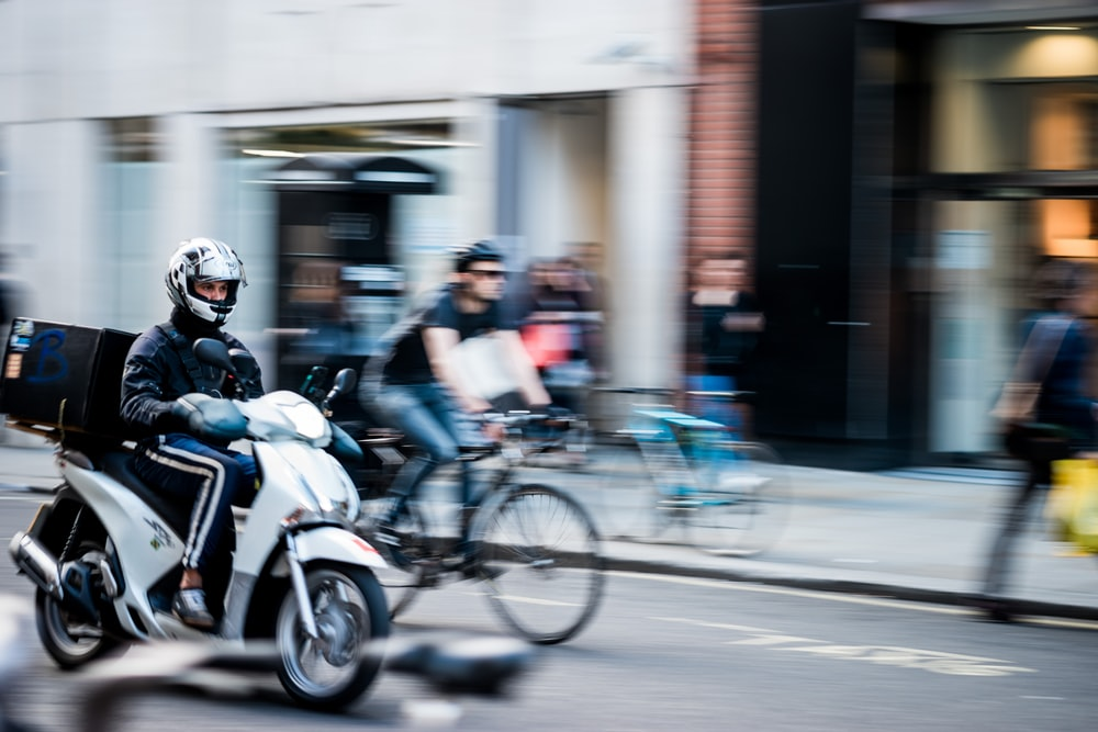 panning photography of motorcycle on road