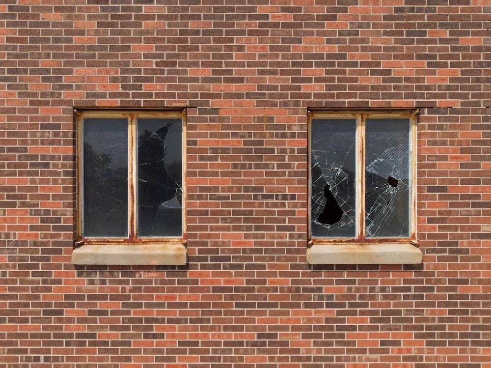 two broken glass building windows
