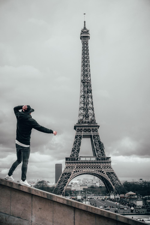 man beside Eiffel Tower