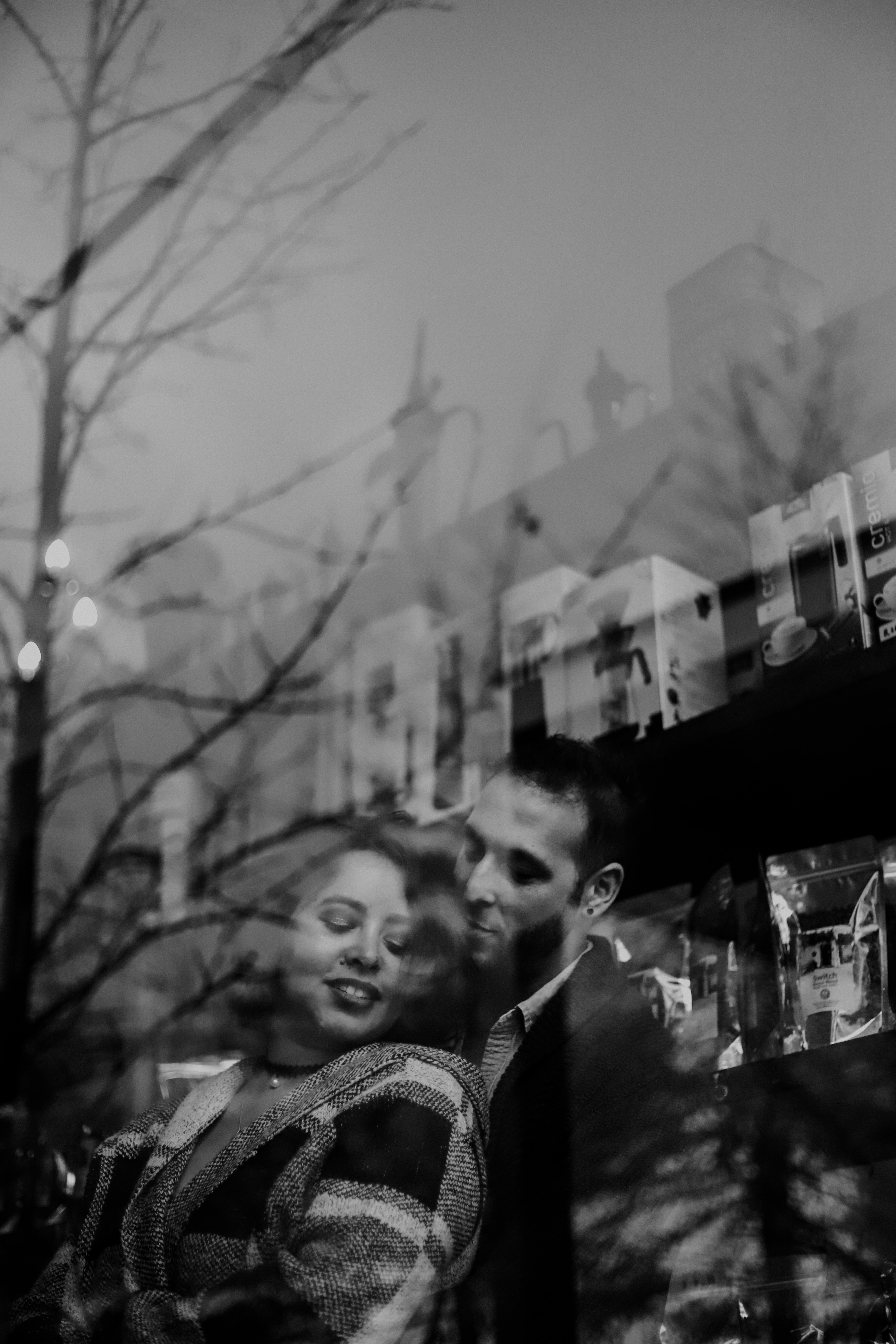 male holding woman from the back grayscale photo