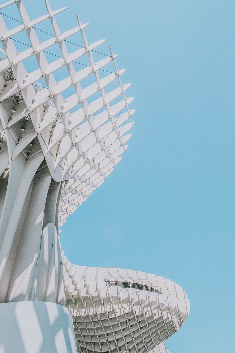 architectural photography of white building under blue skies