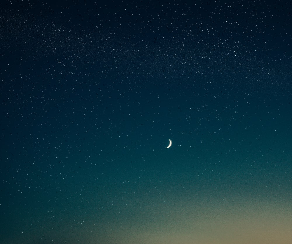 low-angle photography of half moon
