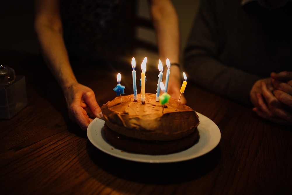 lit candles on chocolate cake