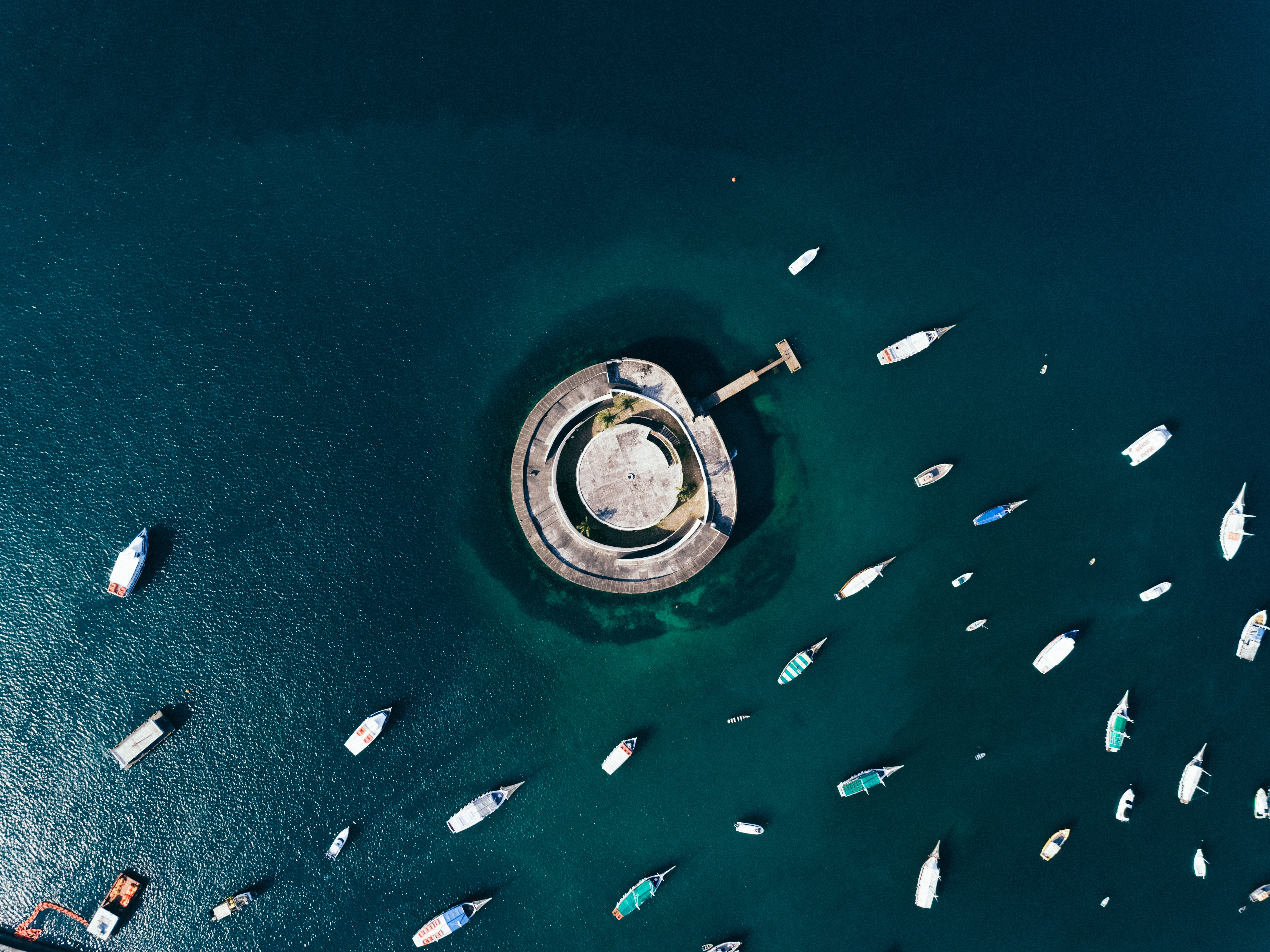 aerial photography of boats and building on body of water during day