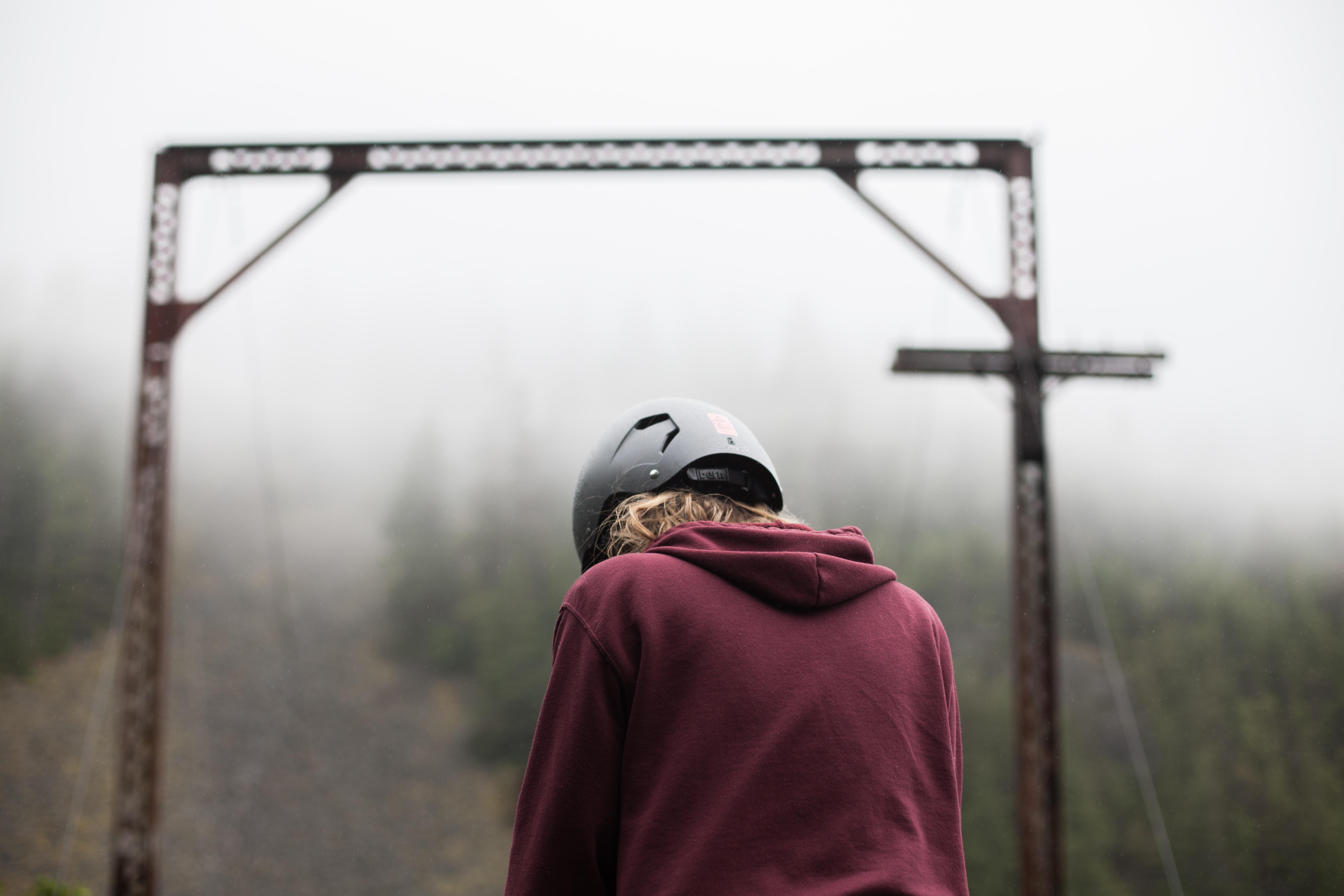 person wearing maroon hoodie