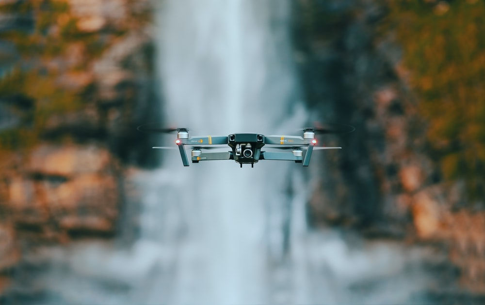 selective focus photography of quadcopter drone