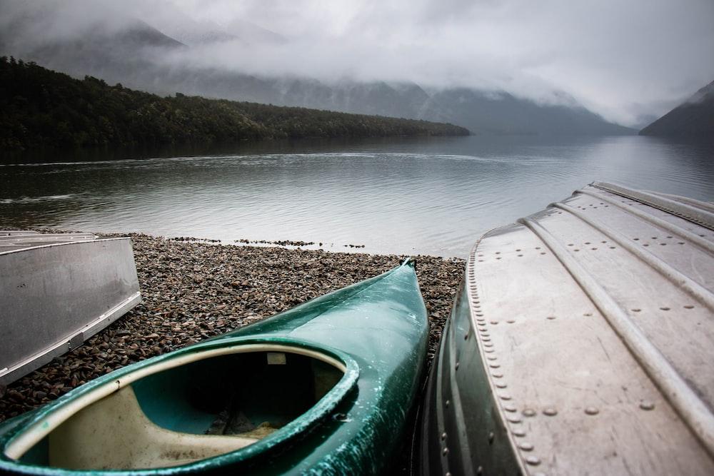 green kayak near body of water