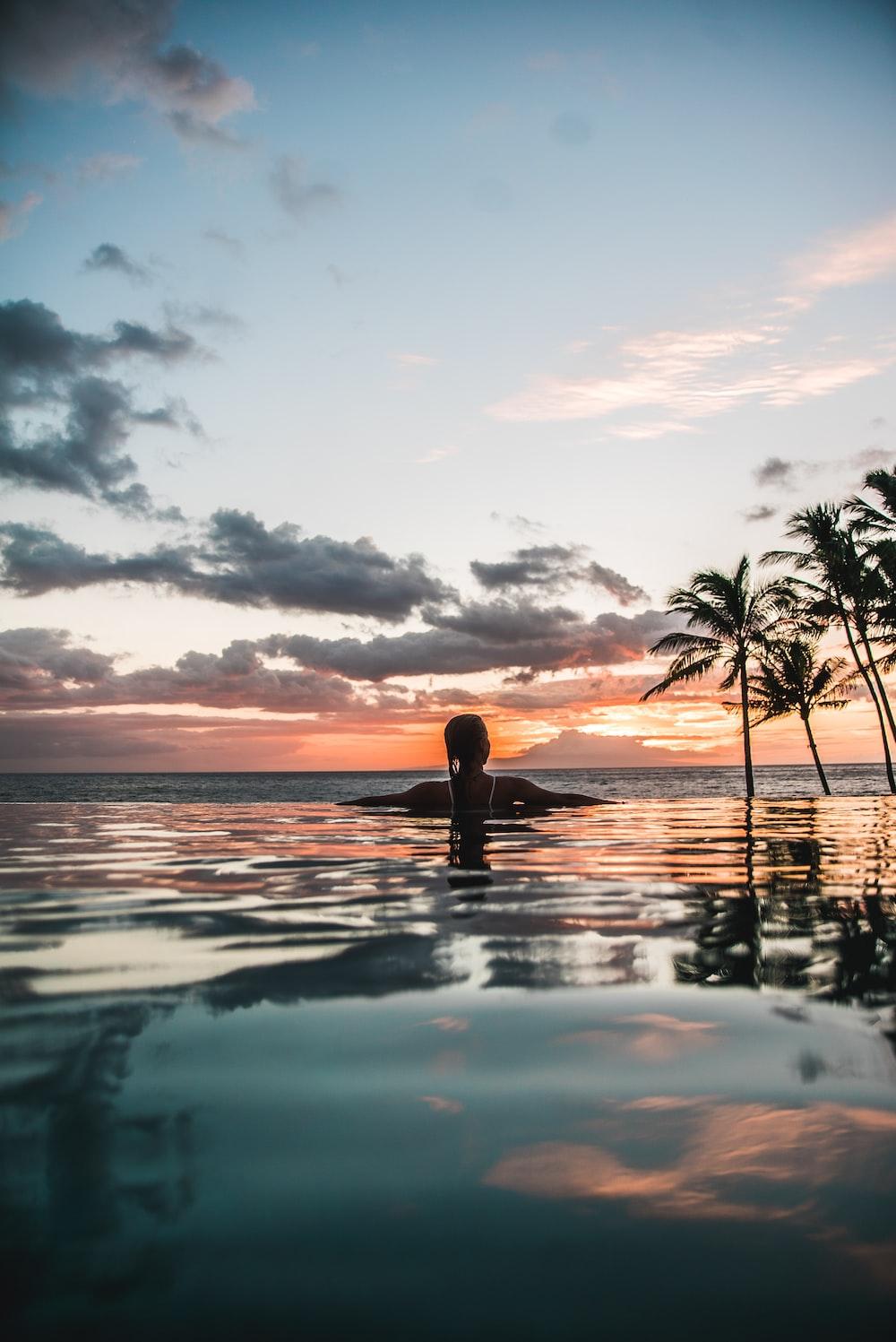 woman swimming on infinity pool