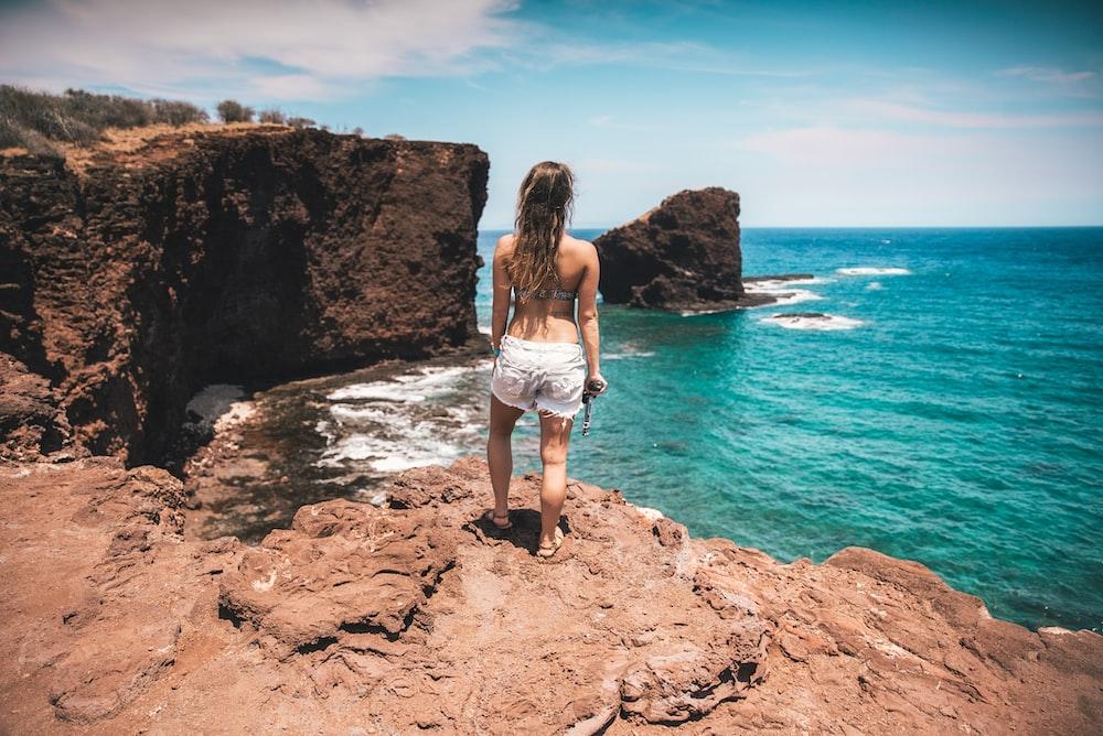 woman standing near ocean during daytime