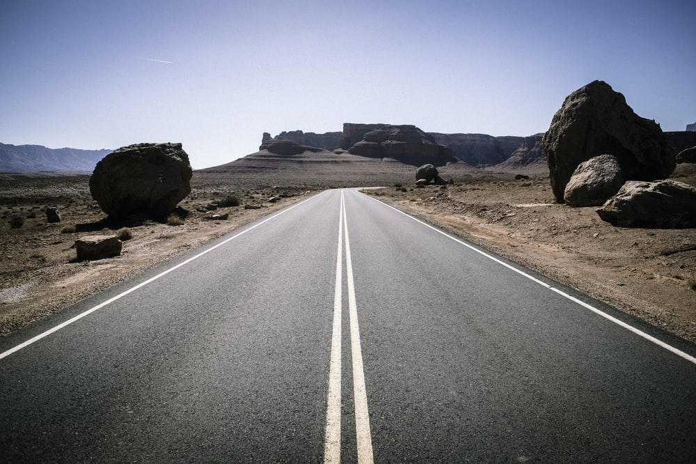 straight line road in the middle of desert