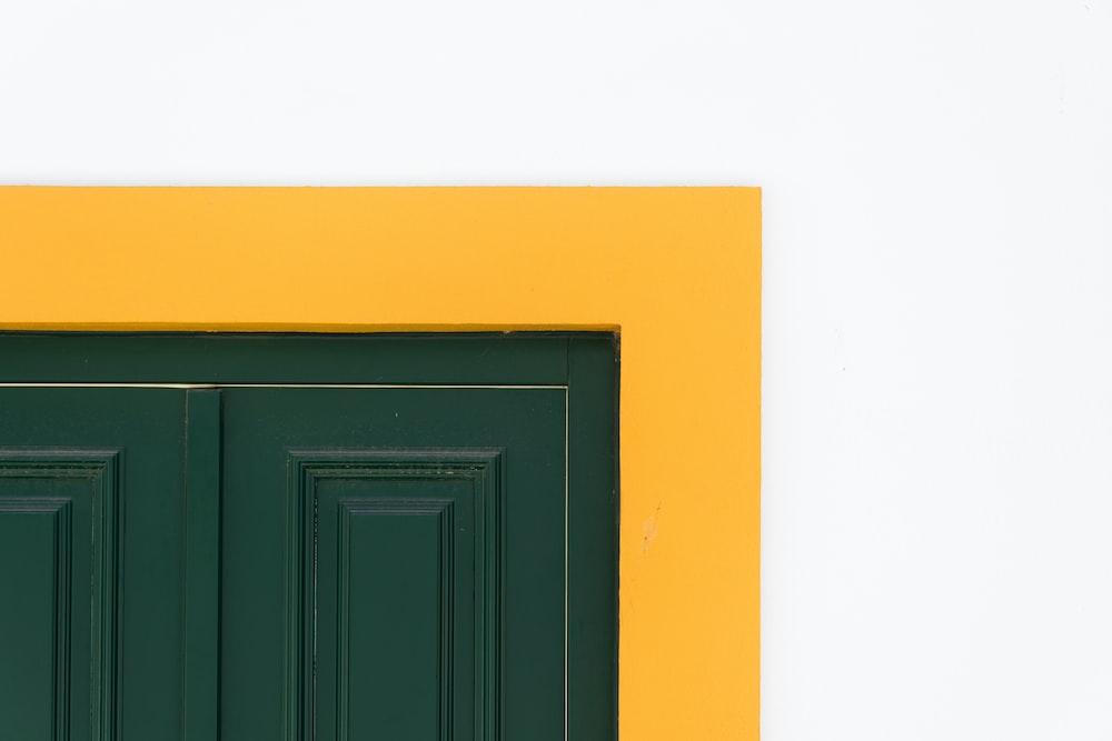 closeup photo of green wooden door