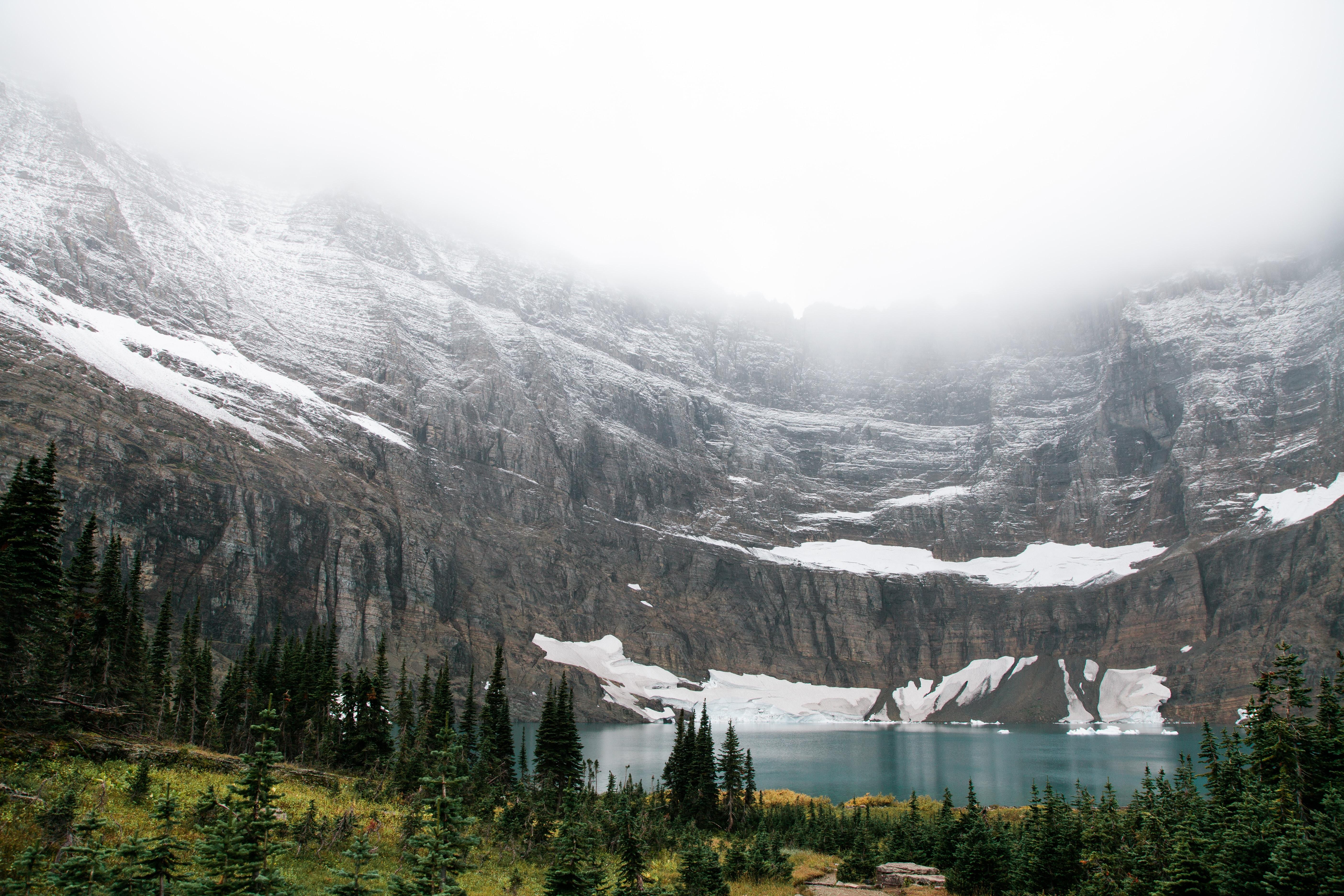 landscape photo of lake near mountain