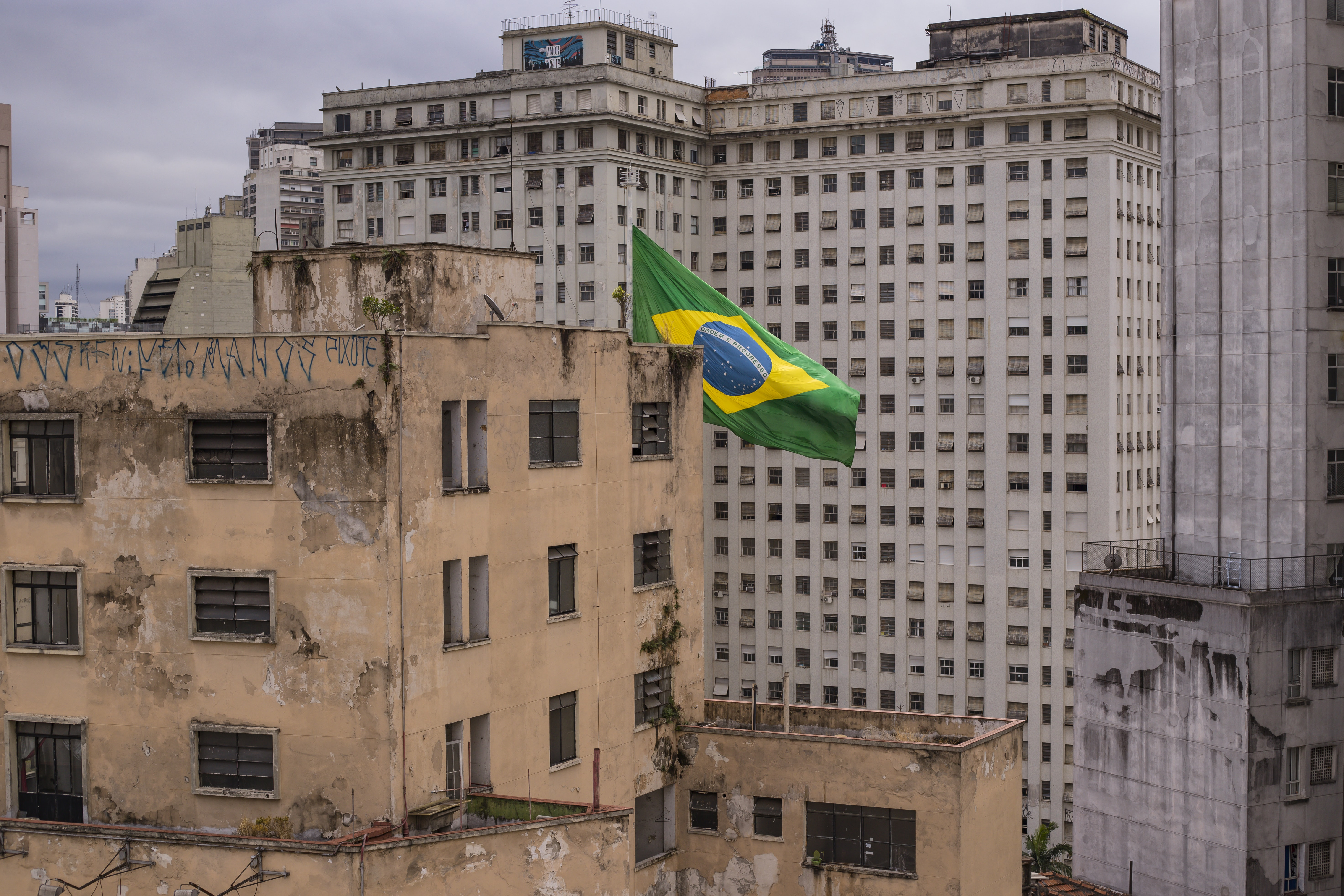 flag of Brazil on top of concrete building